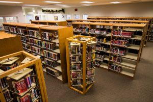 Several rows of books for check out available at the Summerdale Library