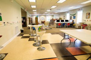 A view of the lounge and children's area at the Summerdale Library