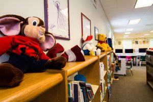 Stuffed animals line the bookshelves in the children's section of the Summerdale Library